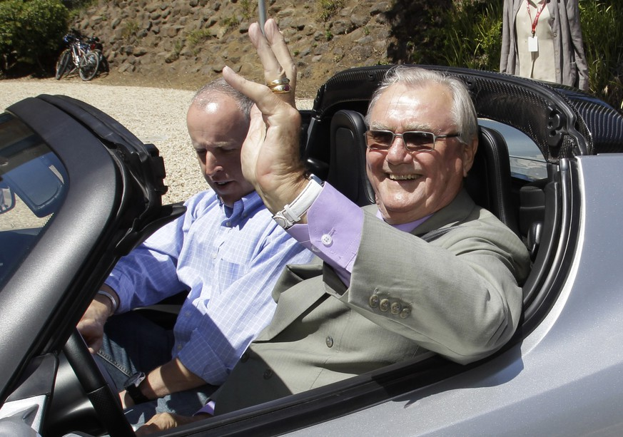 FILE - In this June 13, 2011, file photo, Denmark's Prince Henrik, right, waves as he drives a Tesla Roadster at the electric car maker's headquarters in Palo Alto, Calif. Denmark's royal palace says the 83-year-old Prince Henrik, has been transferred from a Copenhagen hospital to the family's residence north of the capital
