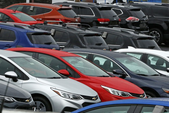 This Thursday, Jan. 12, 2017, photo shows Chevrolet cars on a dealer lot in Pittsburgh. Automakers release vehicle sales for January, on Wednesday, Feb. 1. (AP Photo/Gene J. Puskar)