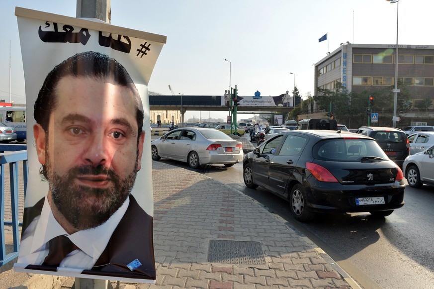 epa06328646 A poster depicting Prime Minister Saad Hariri, who has resigned as Lebanese Prime Minister, with Arabic words that read 'We are all with you' hangs on a street in Beirut, Lebanon, 14 November 2017. Hariri resigned on 04 November 2017 while he was at Saudi Arabia, a move that the media reports as a part of the Saudi-Irani proxy conflict.  EPA/WAEL HAMZEH
