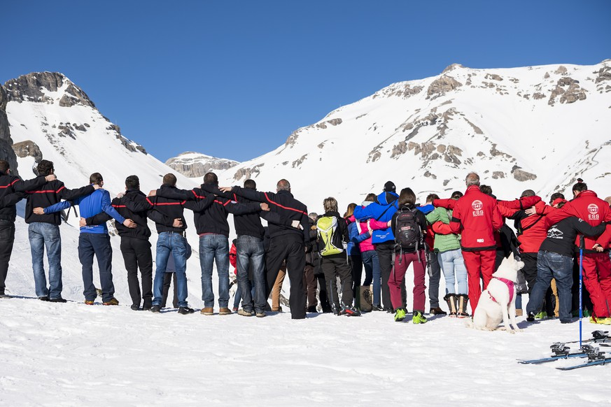 epa07385294 People get together for a minute of silence in memory of the families affected by the avalanche in the ski resort of Crans-Montana, Switzerland, 21 February 2019. Several skiers were swept away by an avalanche yesterday that occurred on the ski slope Kandahar in Crans-Montana. A ski patroller has died from injuries.  EPA/JEAN-CHRISTOPHE BOTT