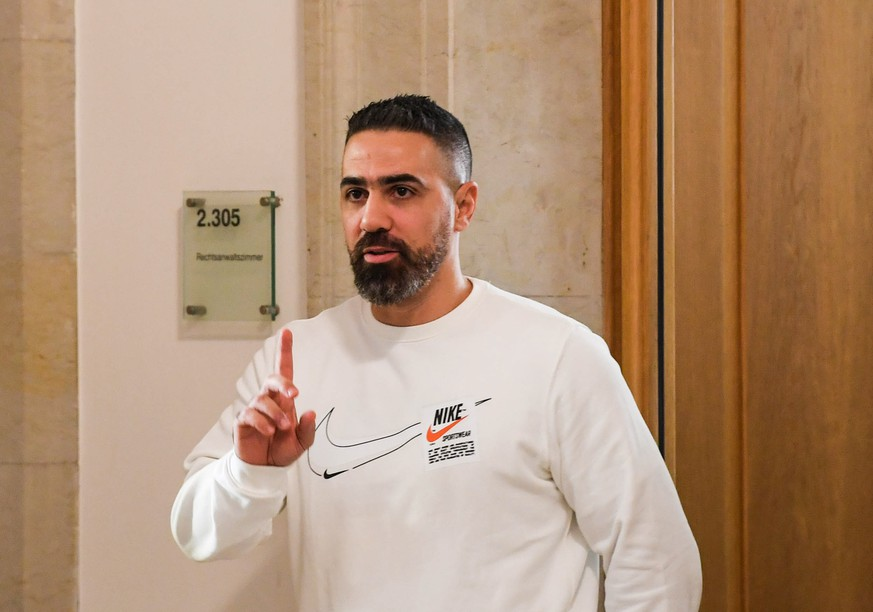 epa07959850 German rapper Bushido at Federal Administrative Court  in Leipzig, Germany, 30 October 2019. Federal Administrative Court  decides on an AfD complaint against the Bushido his album