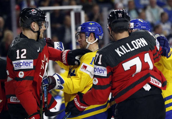 Canada's Colton Parayko, left, pushes Sweden's Oscar Lindberg during the Ice Hockey World Championships final match between Canada and Sweden in the LANXESS arena in Cologne, Germany, Sunday, May 21, 2017. (AP Photo/Petr David Josek)
