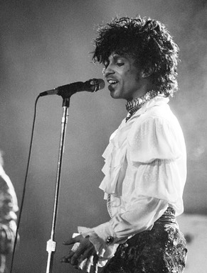 FILE - In this April 7, 1985 file photo, Prince performs at the Orange Bowl during his Purple Rain tour in Miami. Prince, widely acclaimed as one of the most inventive and influential musicians of his era with hits including