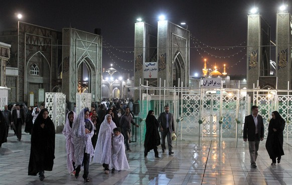 epa08296075 (FILE) - Iranians leave the shrine of Imam Reza in the city of Mashhad, eastern Iran, 12 October 2011 (reissued 15 March 2020). According to reports, Iranian authorities announced the closure of the tomb of Imam Reza in the Shiite city of Mashhad to prevent the spread of the coronavirus. Iran reported 113 new deaths from coronavirus, bringing the total to 724.  EPA/ABEDIN TAHERKENAREH *** Local Caption *** 50075467