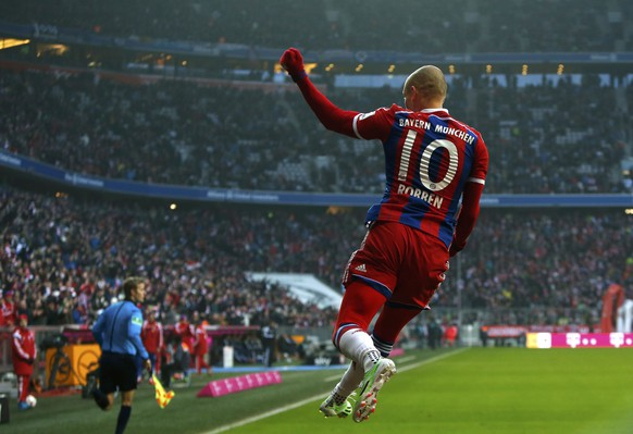 Bayern Munich's Arjen Robben celebrates a goal during the German Bundesliga first division soccer match against Hamburger SV in Munich February 14, 2015.  REUTERS/Michaela Rehle (GERMANY  - Tags: SPORT SOCCER) DFL RULES TO LIMIT THE ONLINE USAGE DURING MATCH TIME TO 15 PICTURES PER GAME. IMAGE SEQUENCES TO SIMULATE VIDEO IS NOT ALLOWED AT ANY TIME. FOR FURTHER QUERIES PLEASE CONTACT DFL DIRECTLY AT + 49 69 650050.