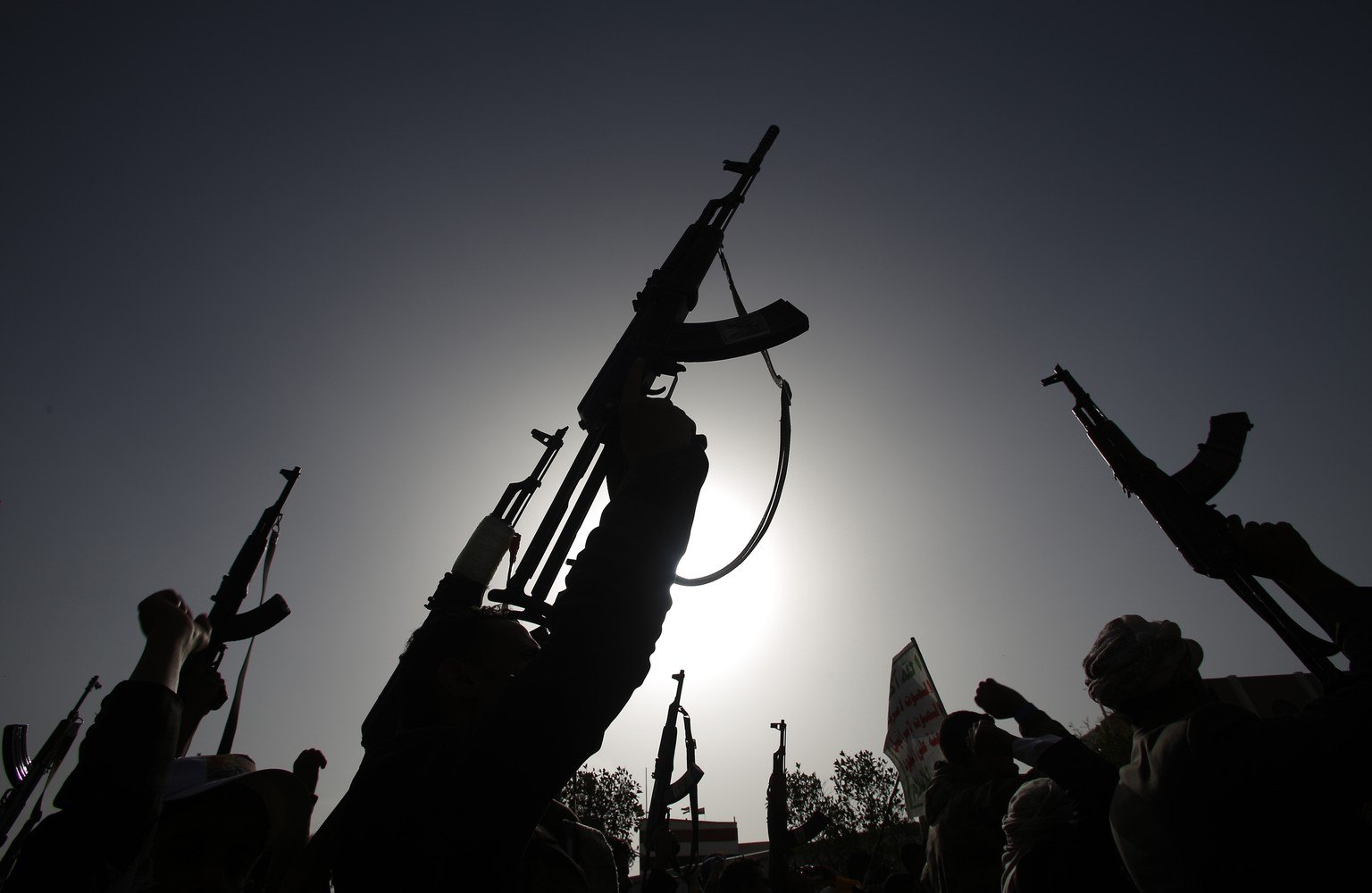 Shiite rebels known as Houthis hold up their weapons to denounce the Saudi-led airstrikes as they chant slogans during a protest in Sanaa, Yemen, Monday, April 27, 2015. Saudi-led airstrikes on Monday targeted Shiite rebels across Yemen, killing several people in the southern port city of Aden and striking a weapons depot in the rebel-held capital, officials and witnesses said. (AP Photo/Hani Mohammed)