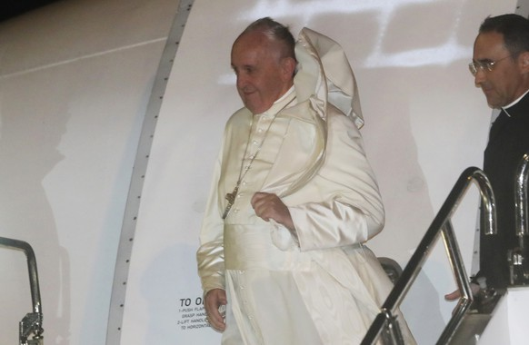 Pope Francis disembarks from his plane upon arrival at Haneda international airport in Tokyo Saturday, Nov. 23, 2019. Pope Francis arrived in Japan for a three-day visit. (AP Photo/Koji Sasahara)