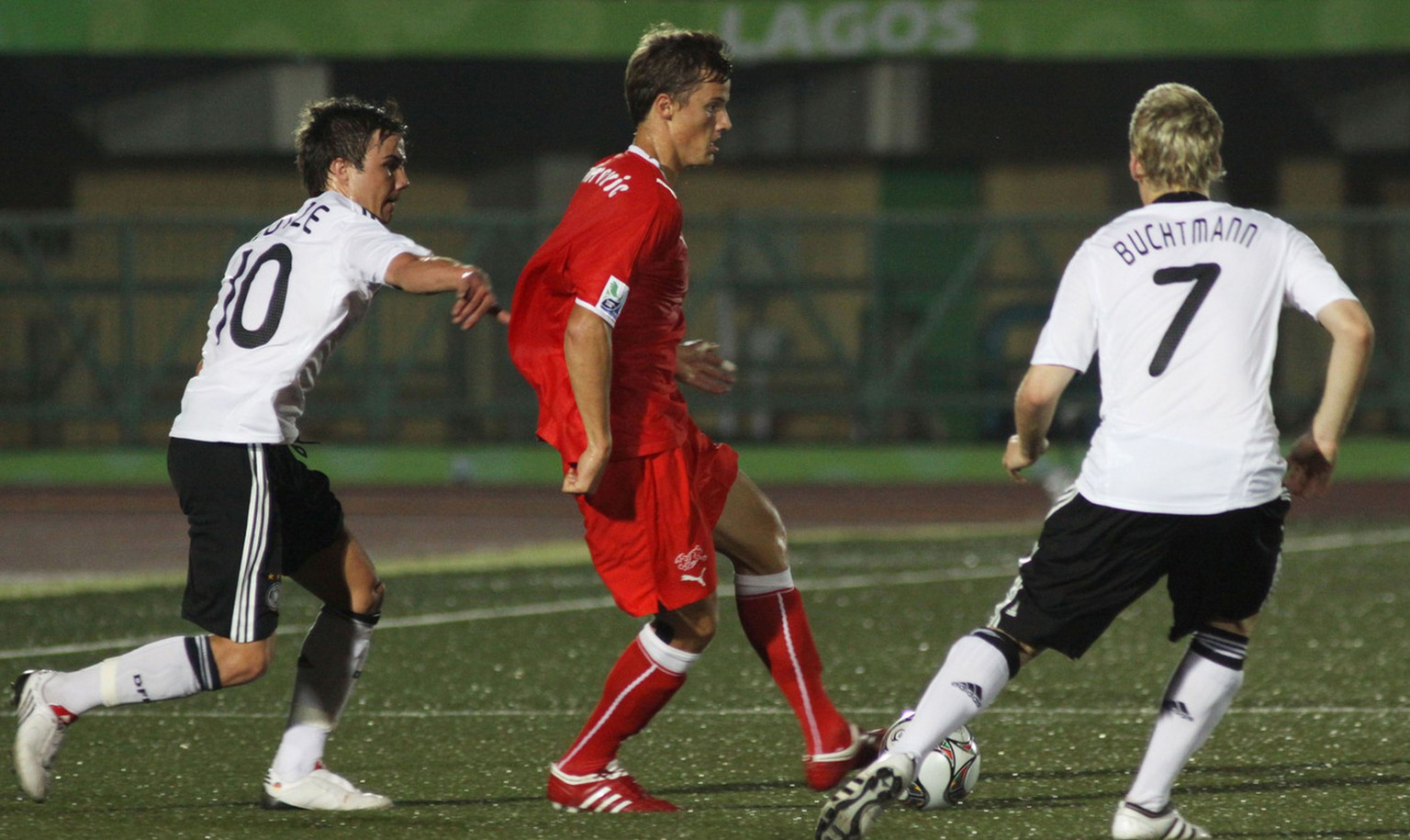 Switzerland's Haris Seferovic, center, is challenged by Germany's Mario Goetze, left, and Christopher Buchtmann during their U17 World Cup round of 16 soccer match in Lagos, Nigeria Wednesday, Nov. 4, 2009. (AP Photo/Sunday Alamba)