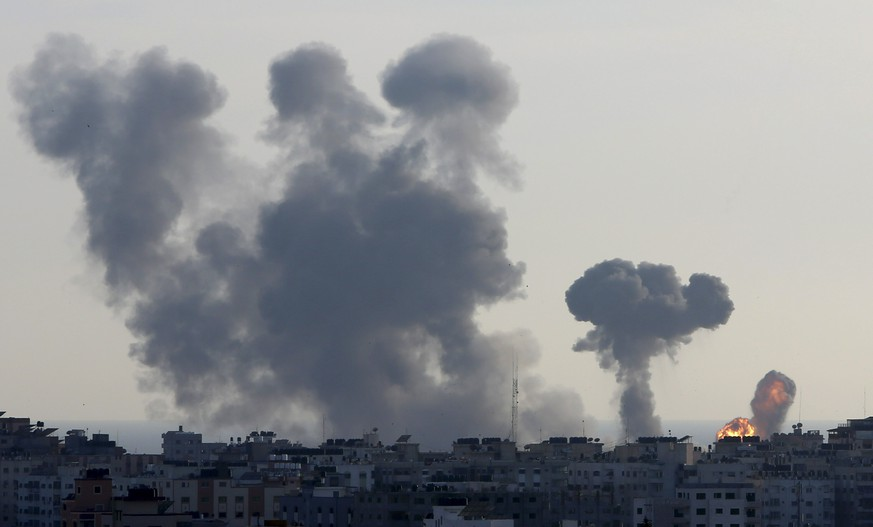 An explosion caused by Israeli airstrikes is seen in Gaza City, Saturday, May 4, 2019. Palestinian militants in the Gaza Strip fired scores of rockets into southern Israel on Saturday, wounding at least two Israeli civilians and triggering retaliatory airstrikes and tank fire against militant targets in the Hamas-ruled enclave and shattering a month-long lull in violence. (AP Photo/Adel Hana)