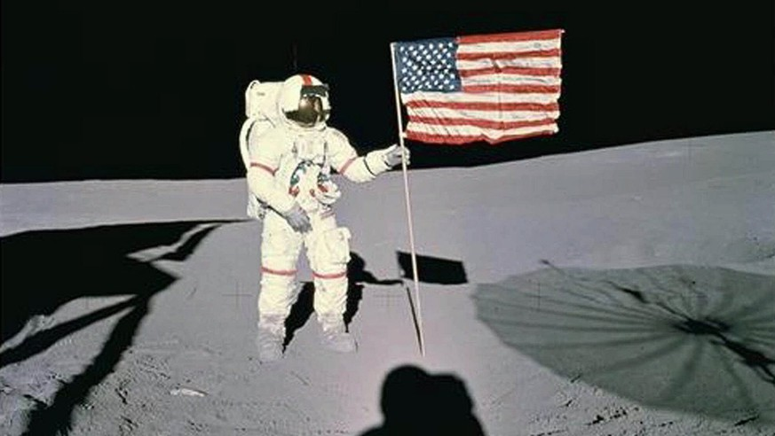 FILE--Astronaut Alan B. Shepard stands with the American Flag on Lunar Surface in this Jan. 13, 1971 file photo. Shepard, the first American to fly in space and the fifth human to walk on the moon, died late Tuesday, July 21, 1998 at a hospital in California. He was 74. (AP Photo/Nasa)