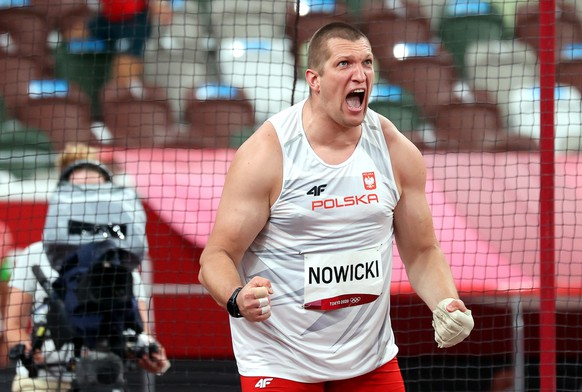 epa09394625 Wojciech Nowicki of Poland reacts in the men's Hammer Throw final during the Athletics events of the Tokyo 2020 Olympic Games at the Olympic Stadium in Tokyo, Japan, 04 August 2021.  EPA/DIEGO AZUBEL
