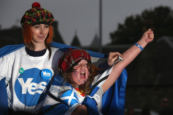 EDINBURGH, SCOTLAND - SEPTEMBER 18:  Debbie Ramsay, aged 24 and Gian Smith, aged eight, wait outside the Scottish Parliament as voting in the referendum continues on September 18, 2014 in Edinburgh, Scotland. After many months of campaigning the people of Scotland today head to the polls to decide the fate of their country.  The referendum is too close to call but a 'Yes' vote would see the break-up of the United Kingdom and Scotland would stand as an independent country for the first time since the formation of the Union.  (Photo by Christopher Furlong/Getty Images)