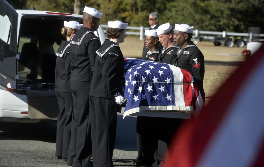 Sailors carry the casket of Cameron Walters at Oak Hill Cemetery in Richmond Hill, Ga., Monday, Dec. 16, 2019. Walters was one of the three Navy sailors killed in a Saudi gunman's attack at Pensacola Naval Air Station in Florida on Dec. 6. Roughly 400 people, including dozens of uniformed service members, attended Monday's funeral earlier in Savannah for Walters. (Steve Bisson/Savannah Morning News via AP)
