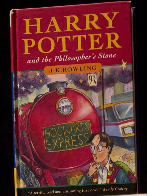 FILE - This May 20, 2013, file photo shows a first edition copy of the first Harry Potter book