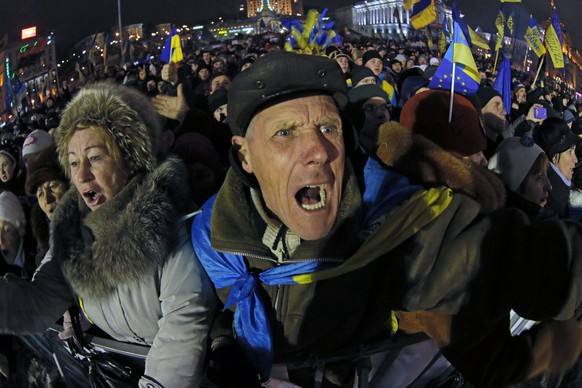 Pro-European Union activists shout as they listen to Ukranian opposition leader Oleh Tyahnybok, during a rally in the Independence Square in Kiev, Ukraine, Friday, Dec. 13, 2013. Ukraine's president proposed an amnesty Friday for all protesters facing criminal charges in the country's wave of massive anti-government demonstrations. President Viktor Yanukovych made the offer at a round-table meeting that included three leaders of the opposition that has orchestrated more than three weeks of anti-government protests, flooding the streets of Kiev with hundreds of thousands of people. (AP Photo/Dmitry Lovetsky)