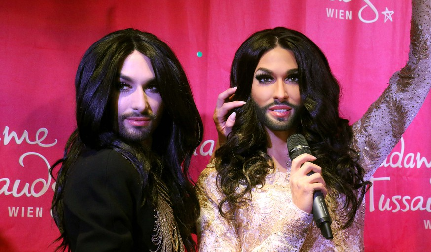 Conchita Wurst, Austrian winner of the Eurovision Song Contest 2014, left, unveils his wax figure at Madame Tussauds in Vienna, Austria, Tuesday, May 12, 2015.  (AP Photo/Ronald Zak)