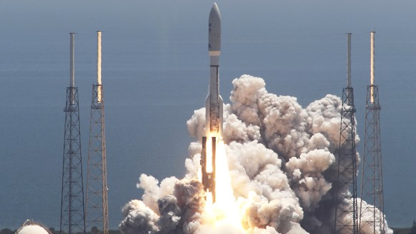 FILE - In this Friday, Aug. 5, 2011 file photo, an Atlas V rocket carrying the Juno spacecraft lifts off from Space Launch Complex-41 in Cape Canaveral, Fla. It was the first step in Juno's 1.7 billion-mile voyage to the gas giant planet, Jupiter. (AP Photo/Terry Renna)