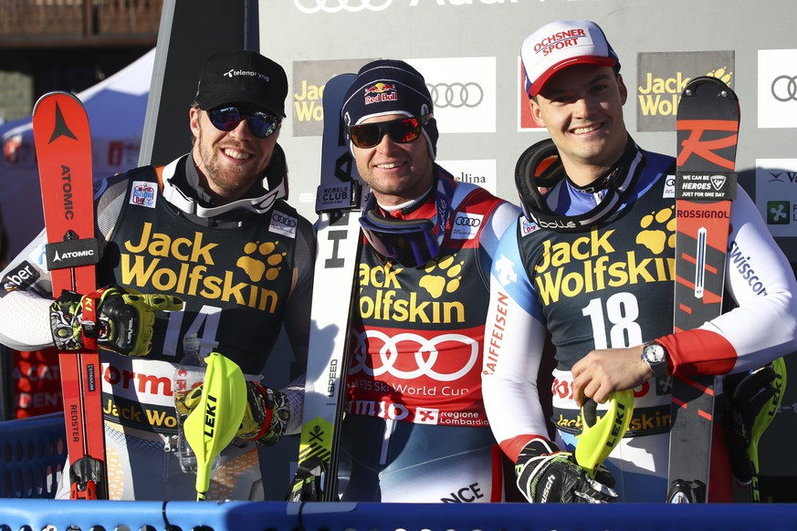 France's Alexis Pinturault, center, winner of an alpine ski, men's World Cup combined, poses with second placed Norway's Aleksander Aamodt Kilde, left, and third placed Switzerland's Loic Meillard, in Bormio, Italy, Sunday Dec. 29, 2019. (AP Photo/Alessandro Trovati)