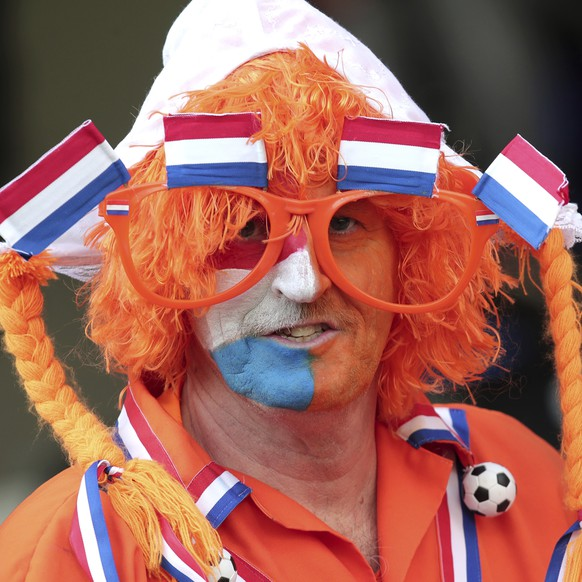 A Netherlands fan waits for the start of the UEFA Nations League semifinal soccer match between Netherlands and England at the D. Afonso Henriques stadium in Guimaraes, Portugal, Thursday, June 6, 2019. (AP Photo/Luis Vieira)