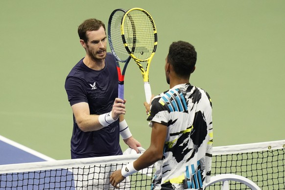 Felix Auger-Aliassime, of Canada, right, taps rackets with Andy Murray, of Great Britain, during the third round of the U.S. Open tennis championships, Thursday, Sept. 3, 2020, in New York. Auger-Aliassime won the match. (AP Photo/Frank Franklin II) Felix Auger-Aliassime,Andy Murray