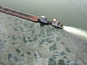 A barge loaded with marine fuel oil sits partially submerged in the Houston Ship Channel in this U.S. Coast Guard picture taken March 22, 2014. The barge leaked oil into the Houston Ship Channel after colliding with another ship near Texas City on Saturday and emergency responders laid down floating barriers to contain the spill, U.S. Coast Guard officials said. The barge, which was being towed by the motor vessel Miss Susan, contained 168,000 gallons (636,000 liters) of fuel oil in the tank that was breached in a collision with a bulk carrier, the Summer Wind, said a Coast Guard spokeswoman. Picture taken March 22, 2014. REUTERS/US Coast Guard/Handout via Reuters  (UNITED STATES - Tags: DISASTER MILITARY ENVIRONMENT ENERGY) ATTENTION EDITORS - THIS PICTURE WAS PROVIDED BY A THIRD PARTY. REUTERS IS UNABLE TO INDEPENDENTLY VERIFY THE AUTHENTICITY, CONTENT, LOCATION OR DATE OF THIS IMAGE. THIS PICTURE IS DISTRIBUTED EXACTLY AS RECEIVED BY REUTERS, AS A SERVICE TO CLIENTS.  FOR EDITORIAL USE ONLY. NOT FOR SALE FOR MARKETING OR ADVERTISING CAMPAIGNS - RTR3I859