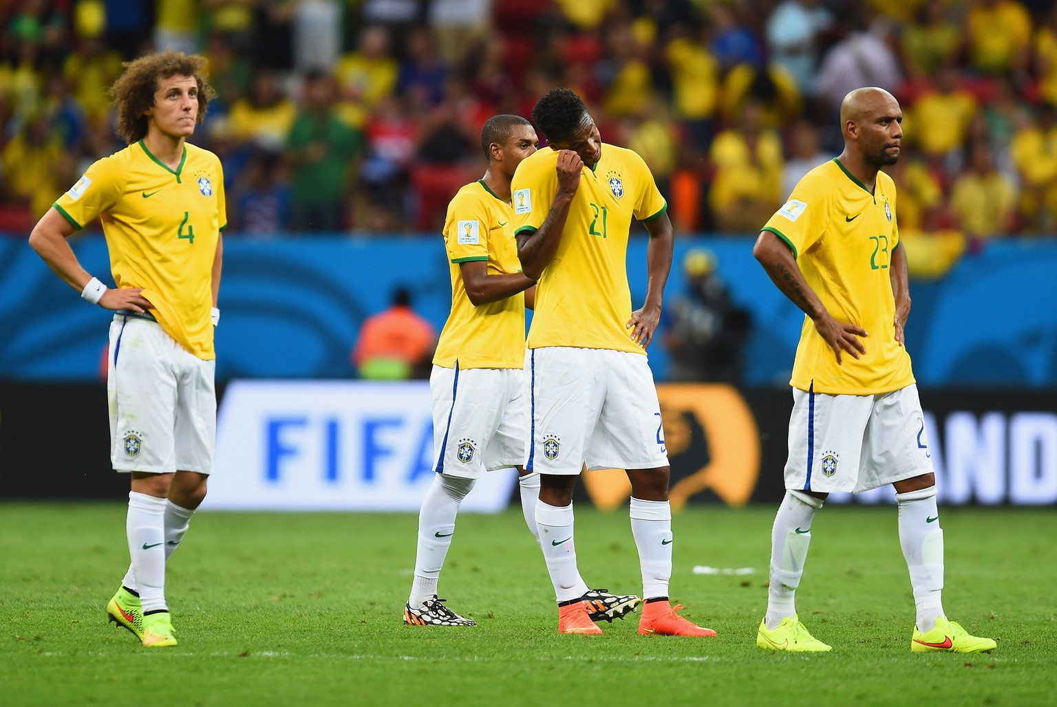 BRASILIA, BRAZIL - JULY 12: (L-R) David Luiz, Fernandinho, Jo and Maicon of Brazil look on after being defeated by the Netherlands 3-0 during the 2014 FIFA World Cup Brazil Third Place Playoff match between Brazil and the Netherlands at Estadio Nacional on July 12, 2014 in Brasilia, Brazil.  (Photo by Jamie McDonald/Getty Images)