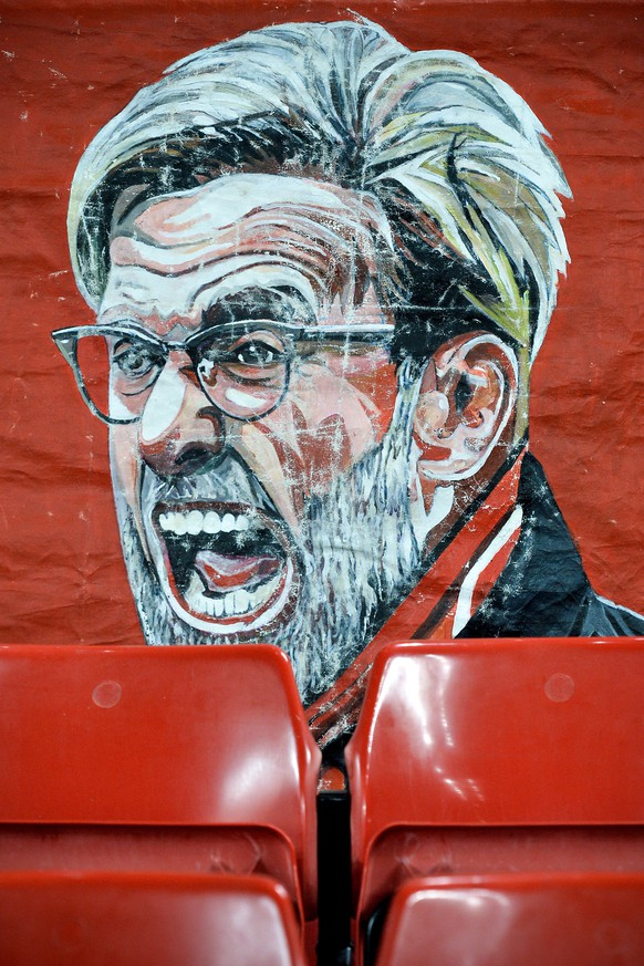 epa07381580 A banner showing Liverpool's head coach Juergen Klopp is seen prior to the UEFA Champions League round of 16 first leg soccer match between Liverpool FC and FC Bayern Muenchen at the Anfield in Liverpool, Britain, 19 February 2019.  EPA/PETER POWELL