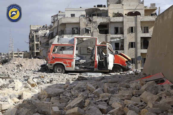 In this photo provided by the Syrian Civil Defense group known as the White Helmets, taken Sept. 23, 2016, a destroyed ambulance is seen outside the Syrian Civil Defense main center after airstrikes in Ansari neighborhood in the rebel-held part of eastern Aleppo, Syria. A year after Russia waded into the war in Syria, aiming to flex its national security muscles and prop up beleaguered Syrian President Bashar Assad, Moscow appears no closer to one of its military goals: getting the U.S. to coordinate combat operations in the civil war. And prospects of a diplomatic resolution seem dim.  (Syrian Civil Defense White Helmets via AP)