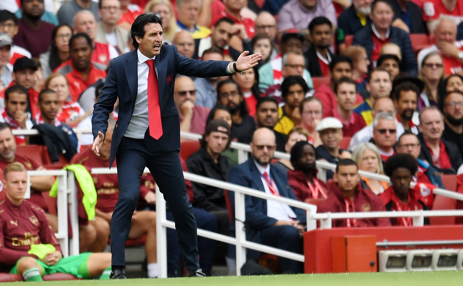epa06946023 Arsenal manager Unai Emery reacts during the English Premier League soccer match between Arsenal FC and Manchester City at the Emirates Stadium in London, Britain, 12 August 2018.  EPA/ANDY RAIN EDITORIAL USE ONLY. No use with unauthorized audio, video, data, fixture lists, club/league logos or 'live' services. Online in-match use limited to 75 images, no video emulation. No use in betting, games or single club/league/player publications.