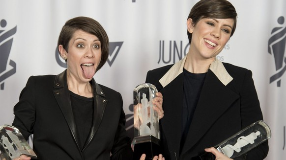 Tegan and Sara celebrate their three Juno Awards during the Junos in Winnipeg, Manitoba on Sunday, March 30, 2014. (AP Photo/The Canadian Press, Jonathan Hayward)