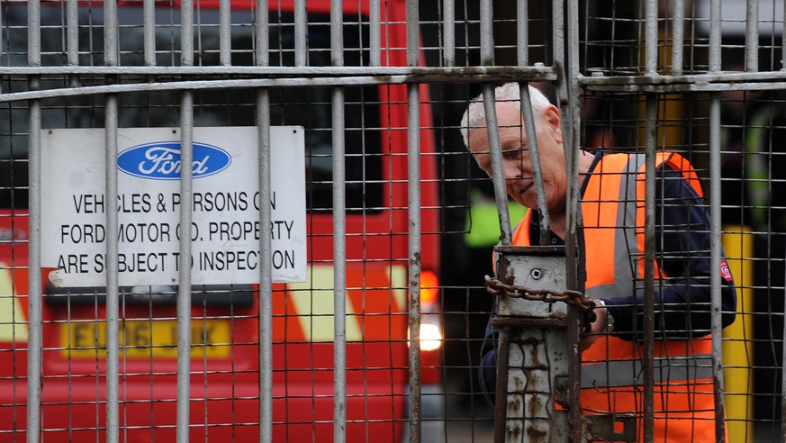 epa07629378 (FILE) - A file photo dated 25 October 2012 showing a Ford employee at the Ford transit van factory in Southampton, Britain (reissued 06 June 2019). British media reports on 06 June 2019 state carmaker Ford is to close its Bridgend, South Wales-located engine manufacturing plant in September 2020. Union officials said 1,700 jobs would be lost following the closure.  EPA/ANDY RAIN