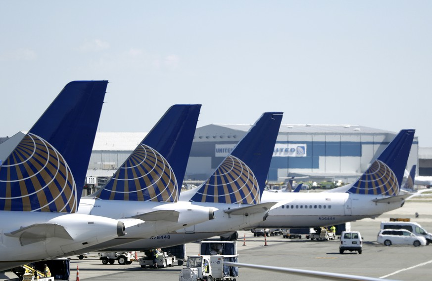 FILE - In this July 18, 2018, file photo, United Airlines commercial jets sit at a gate at Terminal C of Newark Liberty International Airport in Newark, N.J. United Airlines is pulling the Boeing 737 Max from its schedule until March 4, two months longer than before. The move reflects further delays in Boeing's work to fix software and computers that played a role in two deadly crashes overseas. (AP Photo/Julio Cortez, File)