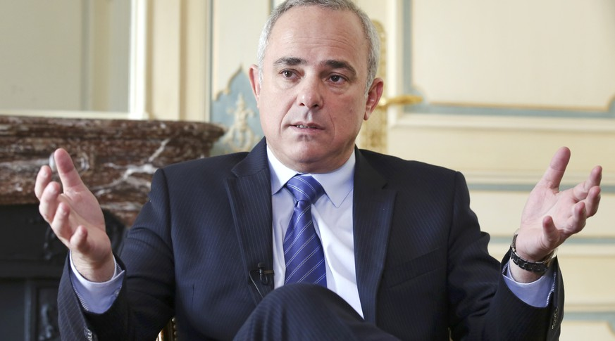 Israeli Intelligence Minister Yuval Steinitz gestures as he speaks during an interview with The Associated Press in Paris, Monday, March 23, 2015. Steinitz said Monday that dialogue with France over Iran's nuclear program