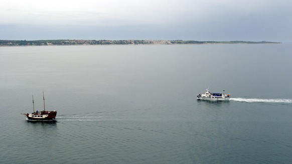 FILE - In this file photo dated May 2005, tourist boats sail in the Piran bay, part of the Adriatic Sea near Portoroz, Slovenia.  Croatia and Slovenia failed on Wednesday July 12, 2017, to reach an mutual agreement on implementing a previous international arbitration ruling granting Slovenia unhindered access to the Adriatic Sea, in a long-standing border dispute stemming from the breakup of Yugoslavia in the 1990s. (AP Photo/Denis Sarkic, FILE)