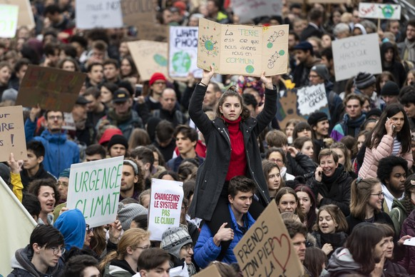 "Thousands of students demonstrate during a ""Climate strike"" protest in Lausanne, Switzerland, Friday, March 15, 2019. Students from several countries worldwide plan to skip class Friday in protest over their governments' failure to act against global warming. (KEYSTONE/Jean-Christophe Bott)"