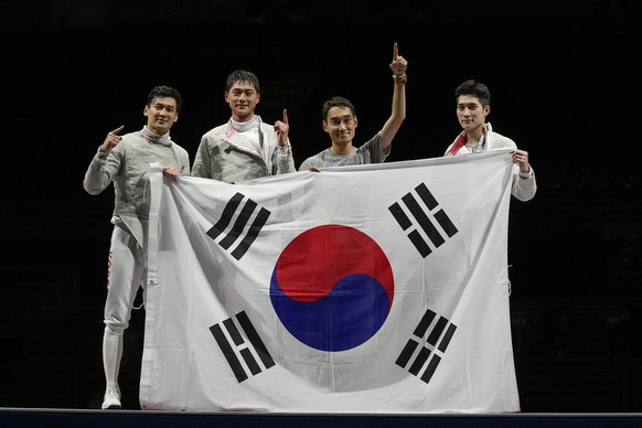 South Korea team fencers celebrate after winning a the men's Sabre team medal at the 2020 Summer Olympics, Wednesday, July 28, 2021, in Chiba, Japan. (AP Photo/Andrew Medichini)