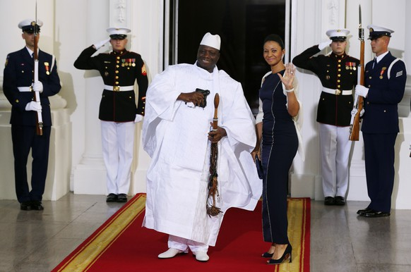 Republic of the Gambia's President Yahya Jammeh and his wife, Zineb Jammeh, arrive for the official U.S.-Africa Leaders Summit dinner hosted by U.S. President Barack Obama at the White House in Washington, August 5, 2014. African leaders on Tuesday called for a deeper economic relationship with the United States, hailing investment pledges totaling more than $17 billion at a Washington summit as a fresh step in the right direction.     REUTERS/Larry Downing   (UNITED STATES - Tags: POLITICS BUSINESS)