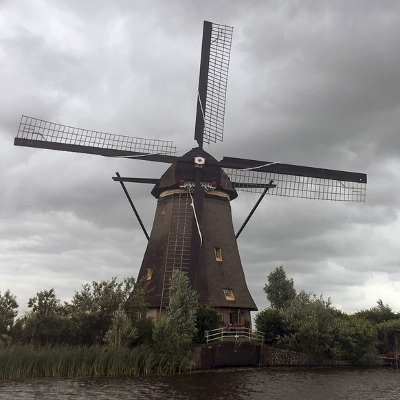 This June 12, 2017 photo shows one of the Kinderdijk windmills in Kinderdijk, Netherlands. The windmills are still used to pump water from low-lying lands in western Netherlands and have become one of the country's most popular tourist destinations. (AP Photo/John Marshall)