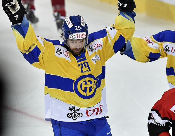 Davos' Beat Forster, left, and Perttu Lundgren celebrate their first score during the game between Switzerland's HC Davos and Team Canada at the 88th Spengler Cup ice hockey tournament in Davos, Switzerland, Friday, December 26, 2014. (KEYSTONE/Peter Schneider)