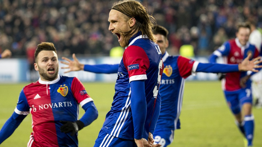 Basel's Michael Lang, center, celebrates with his teammate Basel's Renato Steffen, left, the first goal during the UEFA Champions League Group stage Group A matchday 5 soccer match between Switzerland's FC Basel 1893 and England's Manchester United FC at the St. Jakob-Park stadium in Basel, Switzerland, on Wednesday, November 22, 2017. (KEYSTONE/Patrick Straub)