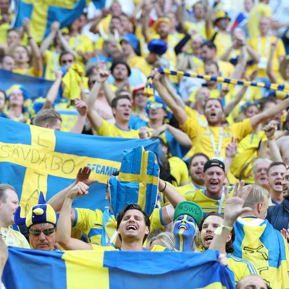 epa06861508 Supporters of Sweden celebrate after the FIFA World Cup 2018 round of 16 soccer match between Sweden and Switzerland in St.Petersburg, Russia, 03 July 2018. Sweden won the match 1-0.(RESTRICTIONS APPLY: Editorial Use Only, not used in association with any commercial entity - Images must not be used in any form of alert service or push service of any kind including via mobile alert services, downloads to mobile devices or MMS messaging - Images must appear as still images and must not emulate match action video footage - No alteration is made to, and no text or image is superimposed over, any published image which: (a) intentionally obscures or removes a sponsor identification image; or (b) adds or overlays the commercial identification of any third party which is not officially associated with the FIFA World Cup)  EPA/TOLGA BOZOGLU   EDITORIAL USE ONLY