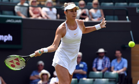epa06875192 Belinda Bencic of Switzerland returns to Angelique Kerber of Germany in their fourth round match during the Wimbledon Championships at the All England Lawn Tennis Club, in London, Britain, 09 July 2018. EPA/GERRY PENNY EDITORIAL USE ONLY/NO COMMERCIAL SALES