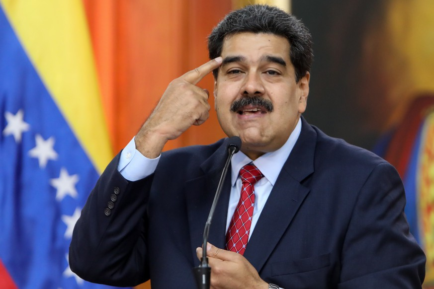 epa07319584 Venezuelan president, Nicolas Maduro, speaks during a press conference from Miraflores Palace, in Caracas, Venezuela, 25 January 2019. Maduro said that the international media that have covered the crisis in the country have 'invisibilized' the Chavista 'force' that has supported him in what he considers a 'coup d'état' led by the president of Parliament, Juan Guaido -who has clained the interim Presidency of the country - and who he said is an 'agent of the yankees'.  EPA/Cristian Hernandez