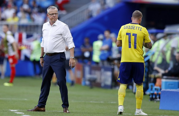 Sweden head coach Janne Andersson, left, looks his player John Guidetti during the quarterfinal match between Sweden and England at the 2018 soccer World Cup in the Samara Arena, in Samara, Russia, Saturday, July 7, 2018. (AP Photo/Alastair Grant)