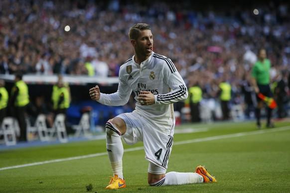 Real Madrid's Sergio Ramos celebrates his goal during a Spanish La Liga soccer match between Real Madrid and Malaga at the Santiago Bernabeu stadium in Madrid, Spain, Saturday, April 18, 2015. (AP Photo/Andres Kudacki)