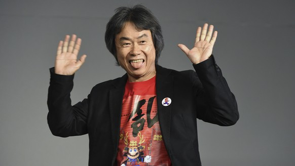 Japanese video game designer and producer Shigeru Miyamoto makes an appearance at the Apple SoHo store to promote Super Mario Run for iOS on Thursday, Dec. 8, 2016, in New York. (Photo by Evan Agostini/Invision/AP)