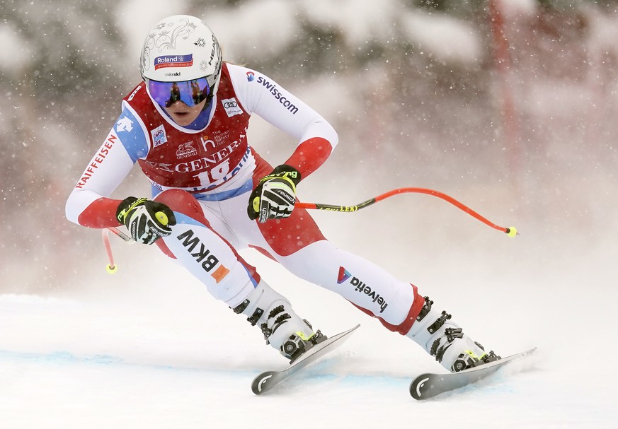 Corinne Suter, of Switzerland, skis down the course during the women's World Cup downhill ski race in Lake Louise, Alberta, Friday, Dec. 6, 2019. (Frank Gunn/The Canadian Press via AP)
