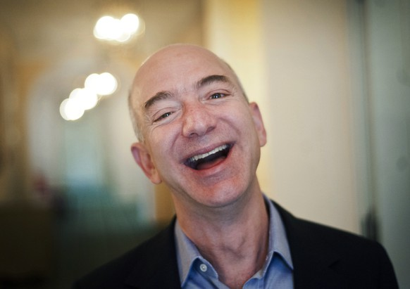 epa07353115 (FILE) - US entrepreneur, founder and president of internet company Amazon, Jeff Bezos smiles at the Bayerischer Hof in Munich, Germany, 11 October 2012 (reissued on 08 February 2019). According to reports, Jeff Bezos accused the publisher of the National Enquirer of trying to extort him, with allegations that AMI threatened to release compromising photos of him in what he described as 'extortion and blackmail'.  EPA/VICTORIA BONN-MEUSER GERMANY OUT *** Local Caption *** 54179944