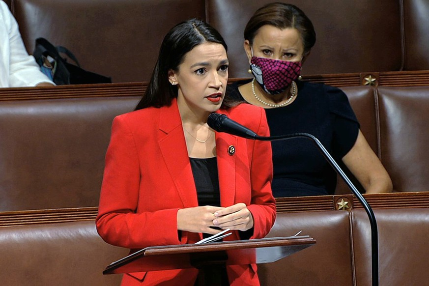 In this image from video, Rep. Alexandria Ocasio-Cortez, D-N.Y., speaks on the House floor, Thursday, July 23, 2020 on Capitol Hill in Washington.   Ocasio-Cortez's objections to a Republican lawmaker's verbal assault on her expanded Thursday as she and other Democrats took to the House floor to demand an end to a sexist culture of â??accepting violence and violent language against women.â?  Rep. Nydia Velázquez, D-N.Y., is seated right. (House Television via AP)