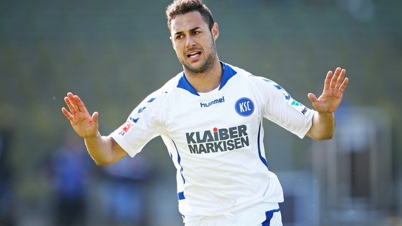 KARLSRUHE, GERMANY - MARCH 09:  Manuel Torres of Karlsruhe celebrates scoring his team's first goal during the Second Bundesliga match between Karlsruher SC and SC Paderborn at Wildparkstadion on March 9, 2014 in Karlsruhe, Germany.  (Photo by Simon Hofmann/Bongarts/Getty Images)